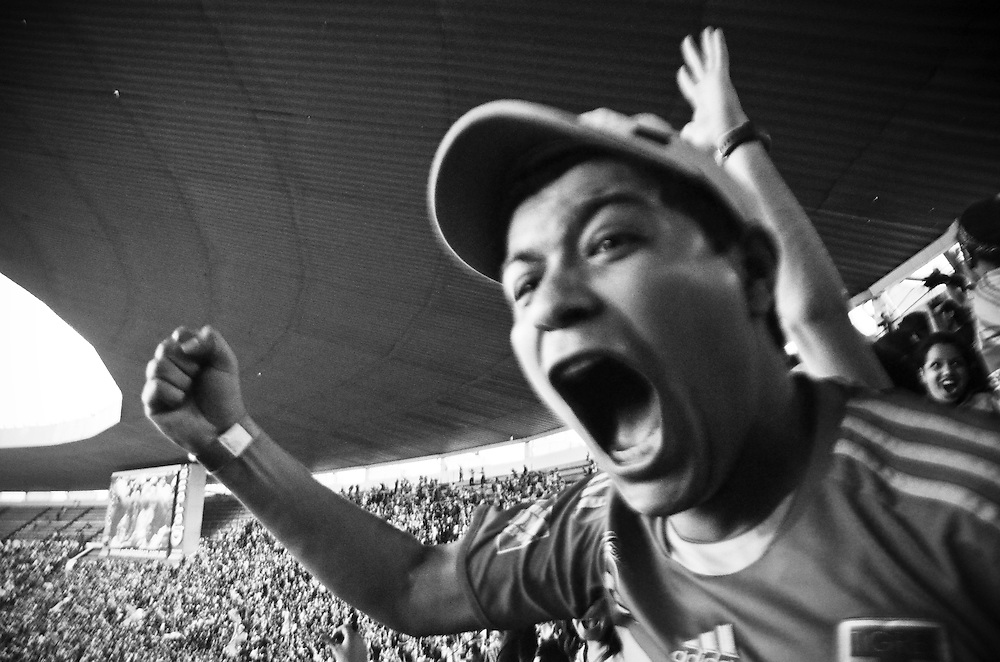 Eric Gomez erupts with fellow fans of the Monterrey Tigres when the only goal of the game is scored during a match against Mexico City's America team at Azteca Stadium, Mexico City, February 5, 2012.