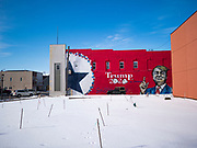 01 FEBRUARY 2020 - BOONE, IOWA: A Jeep is driven past a mural supporting President Donald Trump in downtown Boone, IA. Carl McKnight, a Boone realtor and Donald Trump supporter, commissioned the mural, which he calls nothing more than a campaign sign. Some in Boone, a community about 45 miles northwest of Des Moines, are concerned that the mural, which dominates a new park and bandshell in Boone, is not appropriate in a space shared by all people. A Boone city councilperson said people who donated to the fund to build the park have asked for their donations back. McKnight said the mural will stay up until at least election day.    PHOTO BY JACK KURTZ