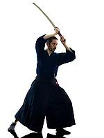 one caucasian man practicing  laido  Katori Shinto ryu isolated shadow silhouette white background