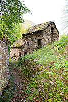 Ticino, Southern Switzerland. An old, Rustico style, dilapidated house down a narrow lane.
