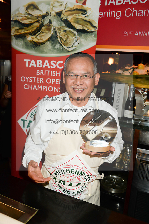 Winner SAM TAMSANGUAN of Wilton's at the Tabasco British Oyster Opening Championship 2013 at J Sheekeys, 28-35 St. Martins Court, London on 9th September 2013.