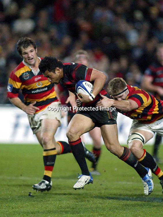 Casey Laulala tries to make a break for Canterbury.<br />Waikato Vs Canterbury, Waikato Stadium, Friday September 24 2004. Canterbury def Waikato 30-15.<br />Photo : Barry Bland / PHOTOSPORT