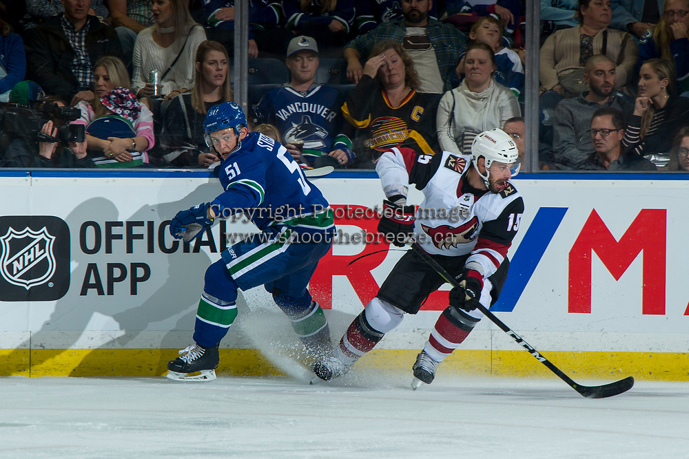 KELOWNA, BC - SEPTEMBER 29:  Troy Stecher #51 of the Vancouver Canucks misses the check on Brad Richardson #15 of the Arizona Coyotes during third period at Prospera Place on September 29, 2018 in Kelowna, Canada. (Photo by Marissa Baecker/NHLI via Getty Images)  *** Local Caption *** Troy Stecher;Brad Richardson