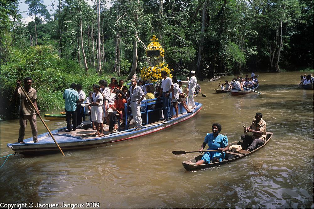 Procession by canoe of Nossa Senhora da Conceicao on small river (rio Caraparu) in tropical rainforest in Para State, Brazil