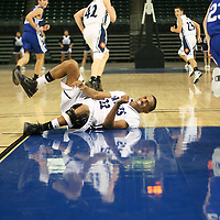 "Pirate guard Timothy ""T.J."" Short rolls painfully on the court after colliding with Lion Hayden Koke (23)"