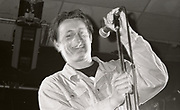 Paul Heaton smiling with microphone, wearing denim jacket, Manchester, circa 1989