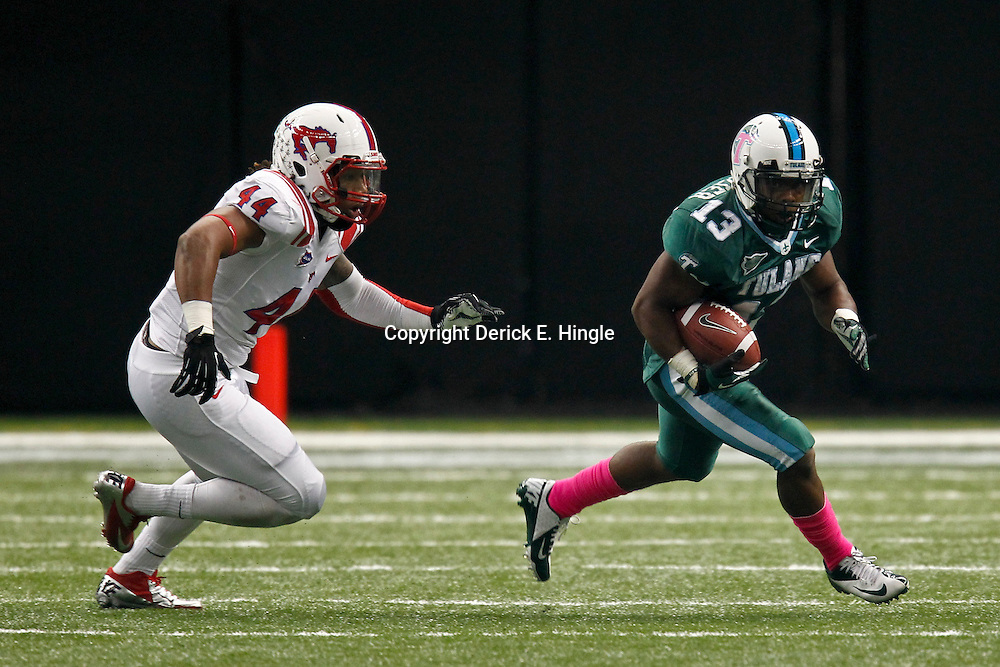 October 13, 2012; New Orleans, LA, USA;  Tulane Green Wave running back Derrick Strozier (13) runs from SMU Mustangs linebacker Taylor Reed (44) during the first quarter of a game at the Mercedes-Benz Superdome.  Mandatory Credit: Derick E. Hingle-US PRESSWIRE