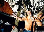 Man singing into his water bottle, Ibiza 1999