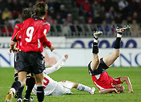Fotball / Soccer<br /> Play off VM 2006 / Play off World Champio0nships 2006<br /> Tsjekkia v Norge 1-0<br /> Czech Republic v Norway 1-0<br /> Agg: 2-0<br /> 16.11.2005<br /> Foto: Morten Olsen, Digitalsport<br /> <br /> Erik Hagen (Zenit St. Petersburg) landing on his neck after a tackle with Tomas Rosicky (Borussia Dortmund)
