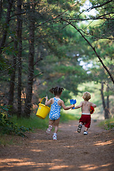 A young sister and brother (ages 2 and 4) head to the beach at the Cape Cod National Seashore in Truro, Massachusetts.  Path from North of Highland Campground.