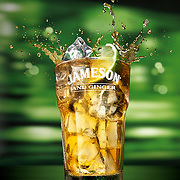 Ice filled glass of Jameson Irish Whiskey with ginger and a slice of lime in front of a green background Ray Massey is an established, award winning, UK professional  photographer, shooting creative advertising and editorial images from his stunning studio in a converted church in Camden Town, London NW1. Ray Massey specialises in drinks and liquids, still life and hands, product, gymnastics, special effects (sfx) and location photography. He is particularly known for dynamic high speed action shots of pours, bubbles, splashes and explosions in beers, champagnes, sodas, cocktails and beverages of all descriptions, as well as perfumes, paint, ink, water – even ice! Ray Massey works throughout the world with advertising agencies, designers, design groups, PR companies and directly with clients. He regularly manages the entire creative process, including post-production composition, manipulation and retouching, working with his team of retouchers to produce final images ready for publication.
