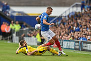 Oxford United Forward, Jamie Mackie (19) slides in on Portsmouth Defender, Lee Brown (3) during the EFL Sky Bet League 1 match between Portsmouth and Oxford United at Fratton Park, Portsmouth, England on 18 August 2018.