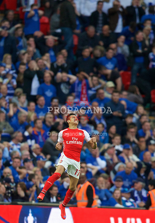 LONDON, ENGLAND - Saturday, April 18, 2015: Arsenal's Alexis Sanchez celebrates scoring the second goal against Reading during the FA Cup Semi-Final match at Wembley Stadium. (Pic by David Rawcliffe/Propaganda)
