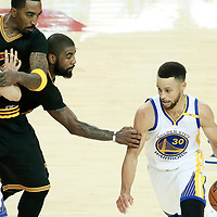 04 June 2017: Golden State Warriors guard Stephen Curry (30) drives past Cleveland Cavaliers guard Kyrie Irving (2) and Cleveland Cavaliers guard JR Smith (5) on a screen set by Golden State Warriors guard Klay Thompson (11) during the Golden State Warriors 132-113 victory over the Cleveland Cavaliers, in game 2 of the 2017 NBA Finals, at the Oracle Arena, Oakland, California, USA.
