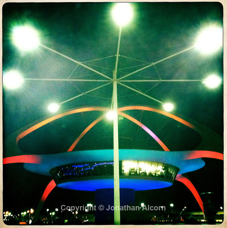 The theme building at LAX - Los Angeles International Airport, seen with streetlights in the foregound. hipstamatic print