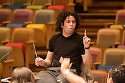 "Simo?n Boli?var Youth Orchestra of Venezuela (SBYOV), rehearsing with its Music Director, conductor Gustavo Dudamel, at the auditorium ""Simo?n Boli?var"" of the ""Centro Latinoamericano de Accio?n Social por la Mu?sica (Center for Social Action Through Music)"". The ""Fundacion del Estado para el Sistema Nacional de las Orquestas Juveniles e Infantiles de Venezuela"" (FESNOJIV, National Network of Youth and Children Orchestras of Venezuela), also known as El Sistema, is a publicly financed private-sector music-education program in Venezuela, originally called Social Action for Music, founded 1975 by Venezuelan economist and amateur musician Jose? Antonio Abreu."