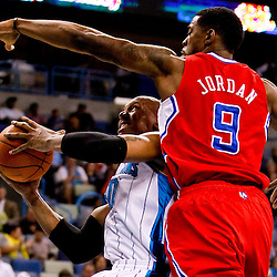 November 9, 2010; New Orleans, LA, USA; New Orleans Hornets power forward David West (30) shoots over Los Angeles Clippers center DeAndre Jordan (9) during the third quarter at the New Orleans Arena. Mandatory Credit: Derick E. Hingle