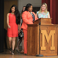 Milam student Zoe Hendrick, walks across the stage to receive her awards after having her name called by teachers Kashauna Pittman and Melanie Plunkett during the Milam Promotion Day Ceremony on Thursday.