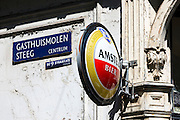 Signs for Gasthuismolensteeg Centrum, the Nine Streets, de 9 Straatjes shopping district and Amstel beer, Amsterdam