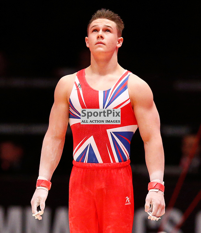2015 Artistic Gymnastics World Championships being held in Glasgow from 23rd October to 1st November 2015...Brinn Bevan (Great Britain) competing in the Horizontal Bar competition..(c) STEPHEN LAWSON | SportPix.org.uk