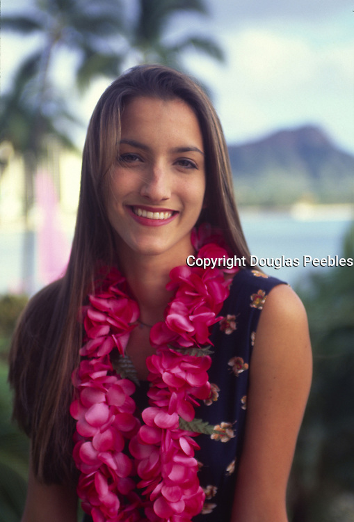 Woman with lei, Waikiki, Oahu, Hawaii<br />