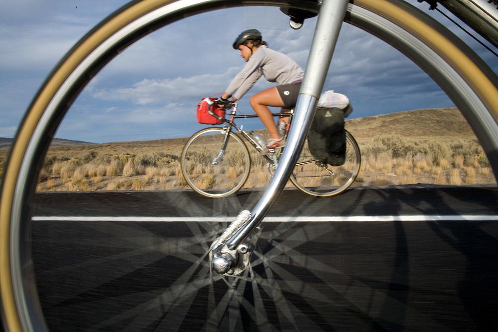 Alexis Erkert rides through Oregon's high desert, Highway 20, Deschutes County, Oregon. 9/22/2007.Photo by Ben Depp
