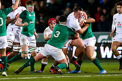 Harvey Beaton of England U20 is tackled by Thomas Clarkson of Ireland U20 - Rogan/JMP - 21/02/2020 - Franklin's Gardens - Northampton, England - England U20 v Ireland U20 - Under 20 Six Nations.