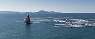 BRAZIL, Itajai. 6th April 2012. Volvo Ocean Race, Leg 5, Auckland-Itajai. Local spectator fleet follow leg leaders Puma powered by BERG.