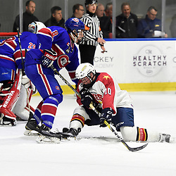 BUFFALO, NY - SEP 20,  2017: Ontario Junior Hockey League Governors Showcase game between the Toronto Jr. Canadiens and Wellington Dukes, Mitch Luzar #8 of the Toronto Jr. Canadiens protects the crease from Graeme McCrory #10 of the Wellington Dukes during the second period.<br /> (Photo by Andy Corneau / OJHL Images)