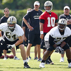 May 24, 2012; Metairie, LA, USA; New Orleans Saints quarterback Chase Daniel (10), offensive tackle Zach Strief (64) and guard Jahri Evans (73) during organized team activities at the team's practice facility. Mandatory Credit: Derick E. Hingle-US PRESSWIRE