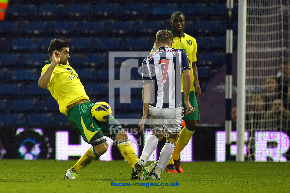 Picture by Paul Chesterton/Focus Images Ltd +44 7904 640267.22/12/2012.Bradley Johnson of Norwich and James Morrison of West Brom in action during the Barclays Premier League match at The Hawthorns, West Bromwich.