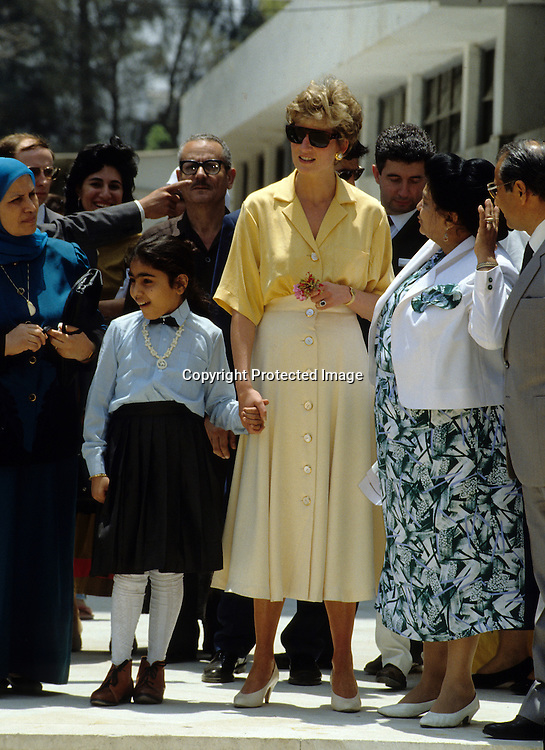 Diana, Princess of Wales hold hands with 10 year old polio sufferer Heba Salah when she visits the Institute of Polio and Rehabilitation in Cairo, Egypt on May 12, 1992.<br />