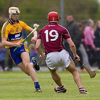 Clare's Aaron Cunningham dodges Galway's Fergal Moore
