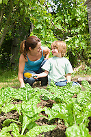 Boy gardening with mother