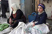Israel, old city of Jerusalem, Mother and daughter at a stall in the street market in the narrow alleys