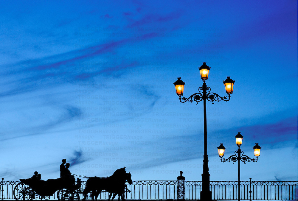 Carriage crossing Triana Bridge, Seville, Spain