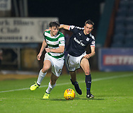 20th September 2017, Dens Park, Dundee, Scotland; Scottish League Cup Quarter-final, Dundee v Celtic; Celtic's Kieran Tierney battles for the ball with Dundee's Cammy Kerr