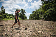 Atchafalaya Basinkeeper, Dean Wilson measuring the pipeline right-of-way in the basin already cleared by workers employed by the  Bayou Bridge Pipeline LLC. <br /> The permit allows a 75 foot wide pipeline right-of-way, which it can clear before construction of the pipeline. Wilson measured the pipeline right-of-way in three spots that have been cleared in the basin on land owned by the state and found the company cleared more than 80ft across.