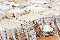 Salt pans and piles of salt near Maras, Peru.  The pans are fed by a natural spring and the salt has been collected since pre-Inca times.