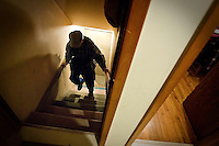 """JEROME A. POLLOS/Press..After retrieving the necessary tools from his basement to finish a home improvement project Jan. 14, Hocker makes his way up a flight of stairs. """"I used to be a lot faster at getting this stuff done, but old age can have it's affects on you. It may take me a little longer now, but I still do it and that's what's important."""""""