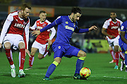 AFC Wimbledon midfielder Chris Whelpdale (11) holds the ball up during the EFL Sky Bet League 1 match between AFC Wimbledon and Fleetwood Town at the Cherry Red Records Stadium, Kingston, England on 26 November 2016. Photo by Stuart Butcher.