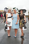 The winner of the Anthony Ryans Best Hat Competition  Alex Butler  with  Rachelle Guiry, winner of Anthony Ryans Best Dressed Lady Competition and the winner of the Anthony Ryans Wear Irish Award Aisling Maher  at the ladies day of The Galway Races. Photo:Andrew Downes