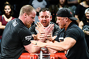 Baltimore, Maryland - May 17, 2018: The hands of World Armwrestling League middleweights Jordan Sill, left, and Craig Tullier are readied by Bart Wood, head referee, during the World Armwrestling League Supermatch Showdown Series at Rams Head Live in Baltimore, Thursday May 17th, 2018. Bleacher Report Live is the exclusive broadcaster of the event. With the recent advent of online video streaming services, niche sporting leagues are now able to sign broadcast deals. <br /> <br /> <br /> CREDIT: Matt Roth for The New York Times<br /> Assignment ID: 30219819A