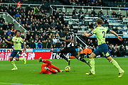 Aaron Ramsdale (#12) of AFC Bournemouth gets down to save at the feet of Allan Saint-Maximin (#10) of Newcastle United during the Premier League match between Newcastle United and Bournemouth at St. James's Park, Newcastle, England on 9 November 2019.