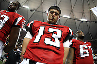 22 November 2007: Quarterback Joey Harrington of the Atlanta Falcons puts his head down during the National Anthem before playing against the Indianapolis Colts before the Colts 31-13 victory over the Falcons at the Georgia Dome on Thanksgiving in Atlanta, Georgia.
