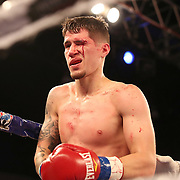 Jovan Perez bleeds from his eyebrow after a foul by Julian Adrian Martinez during a Telemundo boxing match at Osceola Heritage Park on Friday, July 20, 2018 in Kissimmee, Florida.  (Alex Menendez via AP)
