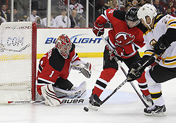 Apr 10; Newark, NJ, USA; Boston Bruins right wing Shawn Thornton (22) and New Jersey Devils defenseman Andy Greene (6) battle for the loose puck in front of New Jersey Devils goalie Johan Hedberg (1) during the first period of their game at the Prudential Center.