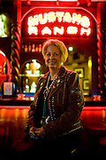 Susan Austin, the madame of the Mustang Ranch Brothel, poses for a portrait at the bar in Mustang, NV, December 2, 2009.