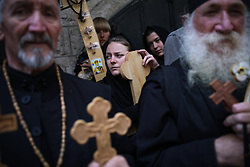 April 14, 2017 - Jerusalem, Israel - A Christian worshipperS hold crosses while taking part in a Good Friday procession on the Via Dolorosa in Jerusalem's Old City on April 14, 2017. Via Dolorosa is believed to be the path that Jesus walked on the way to his crucifixion. (Credit Image: © Corinna Kern/NurPhoto via ZUMA Press)