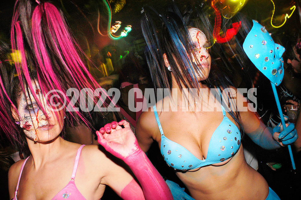 PHILADELPHIA - NOVEMBER 12: Rebecca Neri (L), 29, and Liza Hanson, 28, of United Artists salon in West Reading, Pennsylvania dance in costume during Hairball 9 at Shampoo Niteclub November 12, 2005 in Philadelphia, Pennsylvania. Hairball, which is the East Coast's largest annual hair design competition featured models sporting outrageous themed hair designs and parade the catwalk. All proceeds from the event will benefit cancer and HIV/AIDS research and treatment at the world-renowned City of Hope National Medical Center and Beckman Research Institute. (Photo by William Thomas Cain/photodx.com)